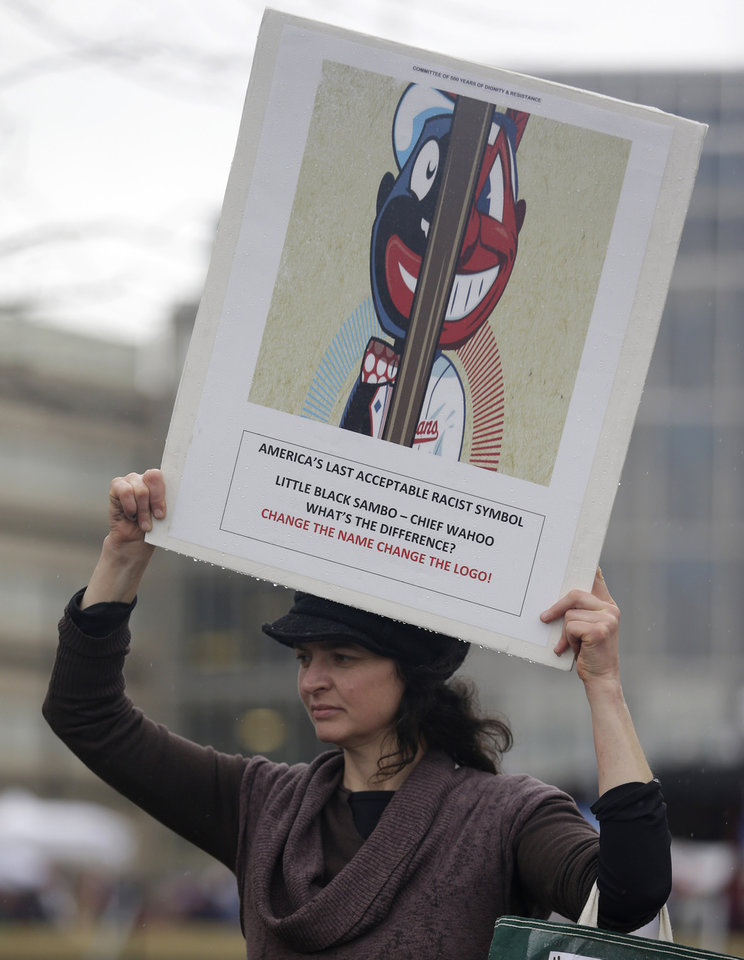 Meagen Kresge protests the use of Chief Wahoo by the Cleveland Indians before a baseball game between the Minnesota Twins and the Cleveland Indians, Friday, April 4, 2014, in Cleveland. (AP Photo/Tony Dejak)
