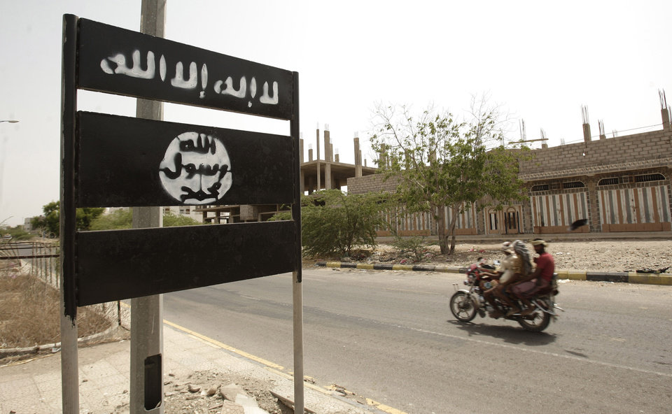 Photo - FILE - In this Friday, June 15, 2012 file photo, an al-Qaida logo is seen on a street sign in the town of Jaar in southern Abyan province, Yemen. Arabic on the logo reads,