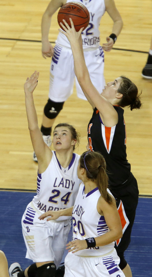 Cheyenne's Kate Sander puts up a shot between Okarche's Madison Lee, and Morgan Vogt, at right, during the Class B boys state championship game between Coyle and Arnett in the State Fair Arena at State Fair Park in Oklahoma City, Saturday, March 2, 2013. Photo by Bryan Terry, The Oklahoman