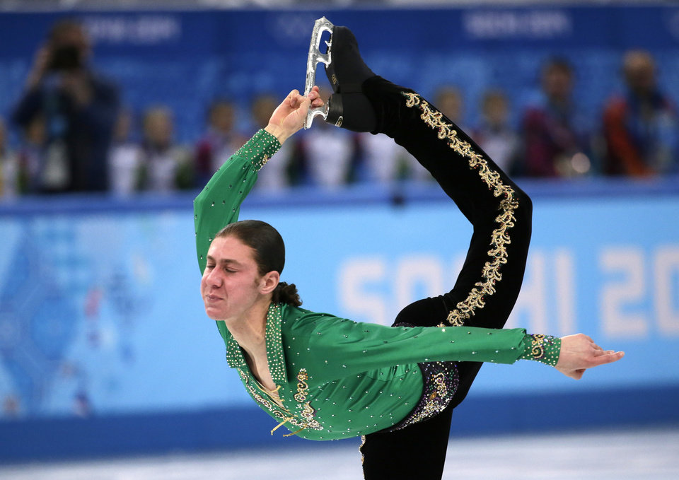 Photo - Jason Brown of the United States competes in the men's team free skate figure skating competition at the Iceberg Skating Palace during the 2014 Winter Olympics, Sunday, Feb. 9, 2014, in Sochi, Russia. (AP Photo/Bernat Armangue)