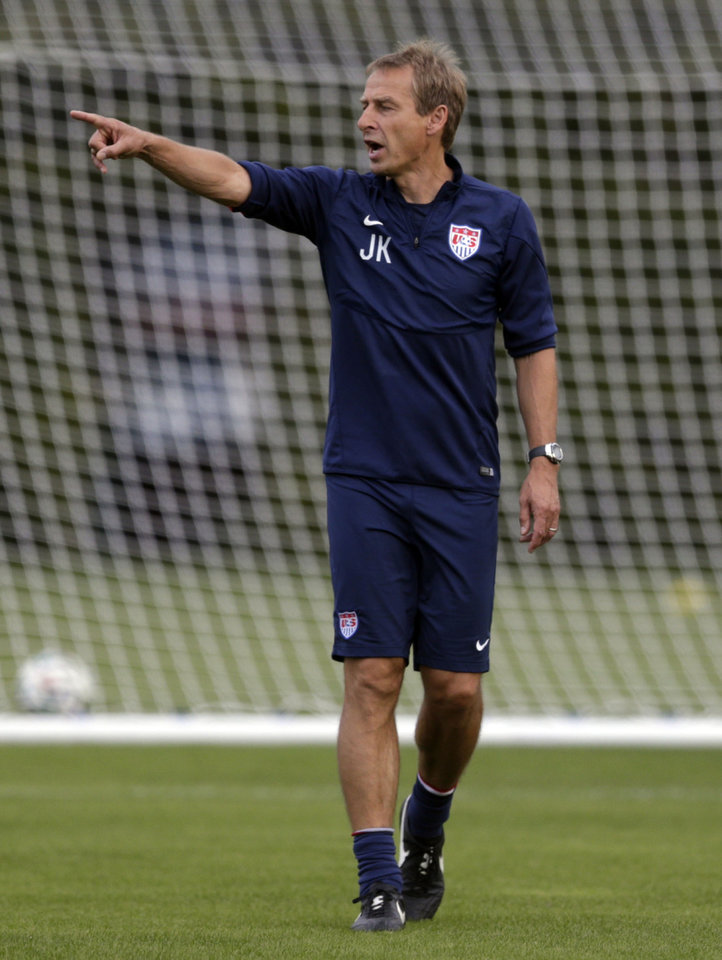 Photo - United States' head coach Jurgen Klinsmann talks to his players during a training session in Sao Paulo, Brazil, Saturday, June 28, 2014. The U.S. will play against Belgium on Tuesday, July 1, in the round 16 of the 2014 soccer World Cup. (AP Photo/Julio Cortez)