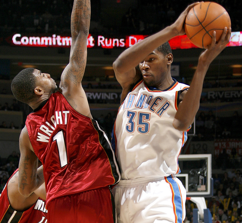 Photo - Oklahoma City's Kevin Durant drives around Miami's Dorell Wright during the NBA basketball game between the Oklahoma City Thunder and the Miami Heat at the Ford Center in Oklahoma City, Saturday, January 16, 2010. Photo by Bryan Terry, The Oklahoman