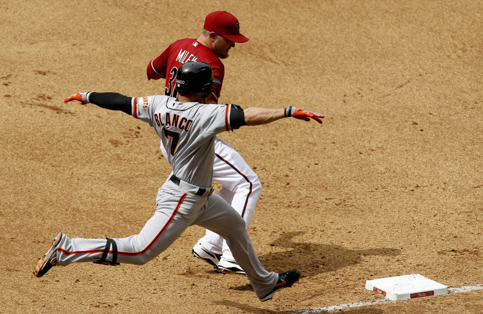 Photo -   Arizona Diamondbacks' Wade Miley just beats San Francisco Giants' Gregor Blanco (7) to first base for the out during the fourth inning in an MLB baseball game Sunday, April 8, 2012, in Phoenix.(AP Photo/Ross D. Franklin)