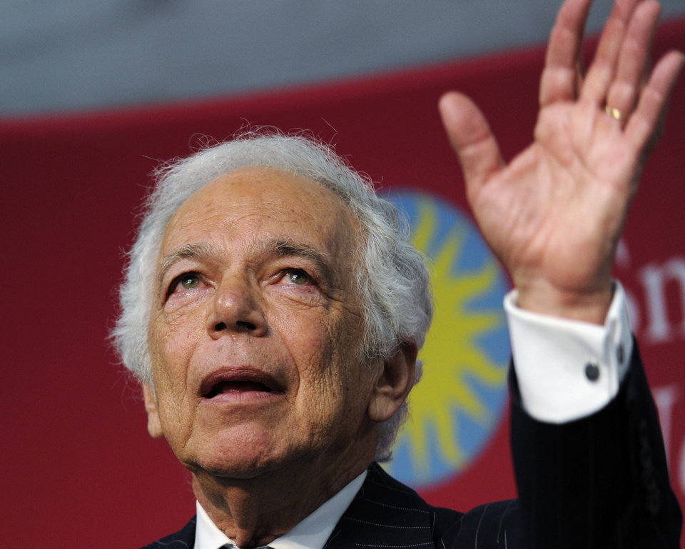 "Photo - Designer Ralph Lauren waves after receiving the James Smithson Bicentennial Medal ""for his embodiment of the American experience through the medium of fashion, design and philanthropy"