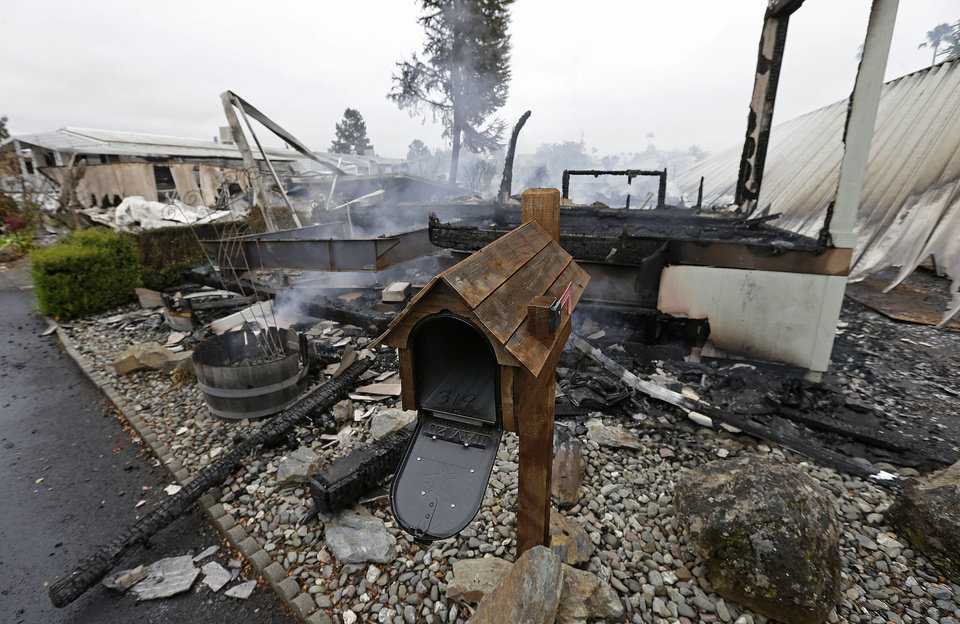 Photo - A mailbox is all that remains of one of four mobile homes which were destroyed in a gas fire Sunday, Aug. 24, 2014, at the Napa Valley Mobile Home Park, in Napa, Calif. A large earthquake caused significant damage and left at least three critically injured in California's northern Bay Area early Sunday, igniting fires, sending at least 87 people to a hospital, knocking out power to tens of thousands and sending residents running out of their homes in the darkness. (AP Photo/Ben Margot)