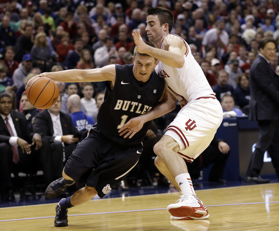 Butler guard Rotnei Clarke, left, drives on Indiana forward Will Sheehey in the first half of an NCAA college basketball game in Indianapolis, Saturday, Dec. 15, 2012.  (AP Photo/Michael Conroy) ORG XMIT: INMC102