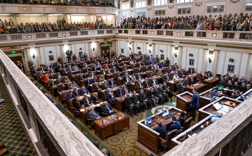 Photo - Legislators gather in the House of Representatives as Gov. Kevin Stitt delivers his State of the State Address in the House Chambers of the Oklahoma House of Representative in Oklahoma City, Okla. on Monday, Feb. 3, 2020.  [Chris Landsberger/The Oklahoman]