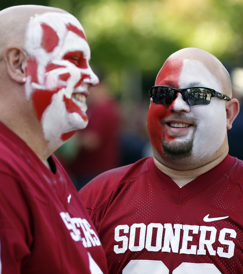 Photo - OU fans Jeff Jordan, of Edmond, Okla., and Adam Bujalski, of Elkhart, Ind., talk outside the stadium before a college football game between the University of Oklahoma Sooners (OU) and the Notre Dame Fighting Irish at Notre Dame Stadium in South Bend, Ind., Saturday, Sept. 28, 2013. Photo by Nate Billings, The Oklahoman