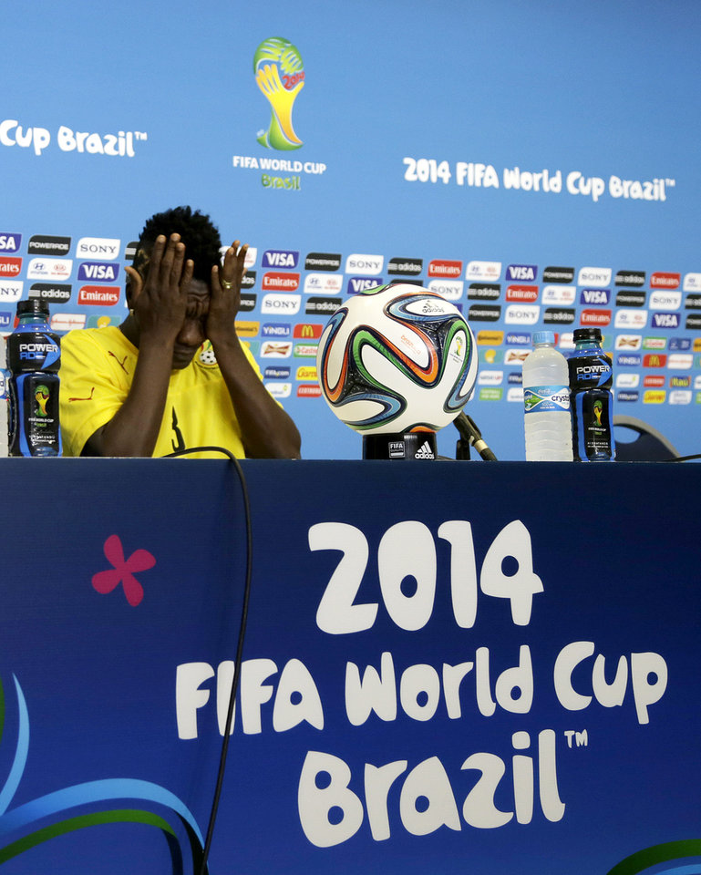 Photo - Ghana's Asamoah Gyan prepares himself before a news conference ahead of an official training session the day before the group G World Cup soccer match between Ghana and the United States at the Arena das Dunas in Natal, Brazil, Sunday, June 15, 2014.  (AP Photo/Dolores Ochoa)