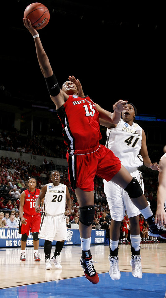 Rutgers' Kia Vaughn scores in front of Purdue's Alex Guyton during the NCAA women's basketball tournament game between Rutgers and Purdue at the Ford Center in Oklahoma City, Sunday, March 29, 2009.  PHOTO BY BRYAN TERRY, THE OKLAHOMAN