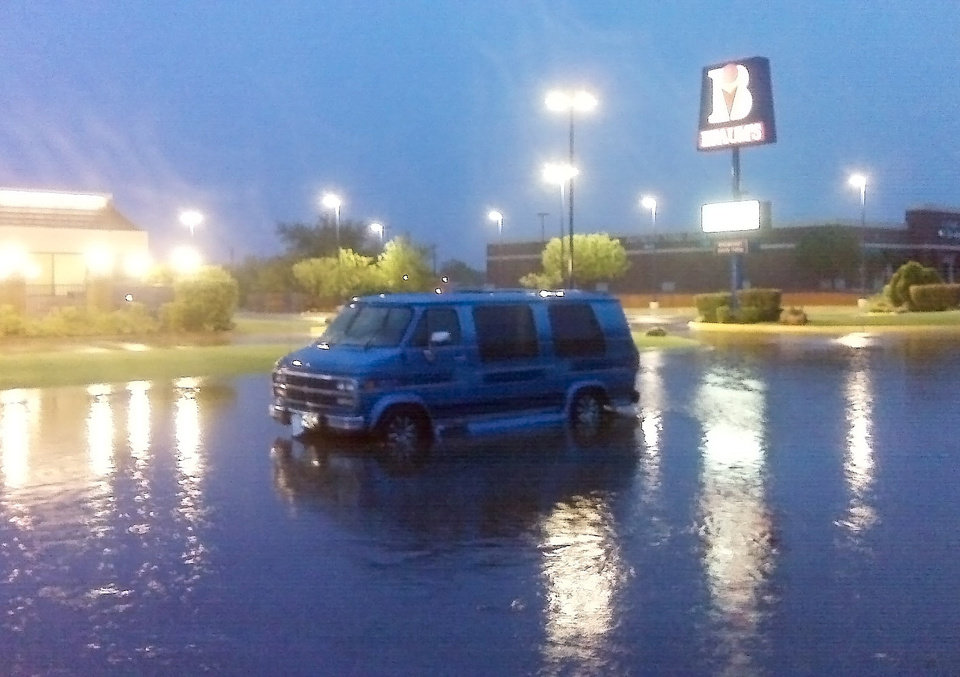 Photo - A stalled van at NW 62 an N May. Photo by Robert Medley, The Oklahoman