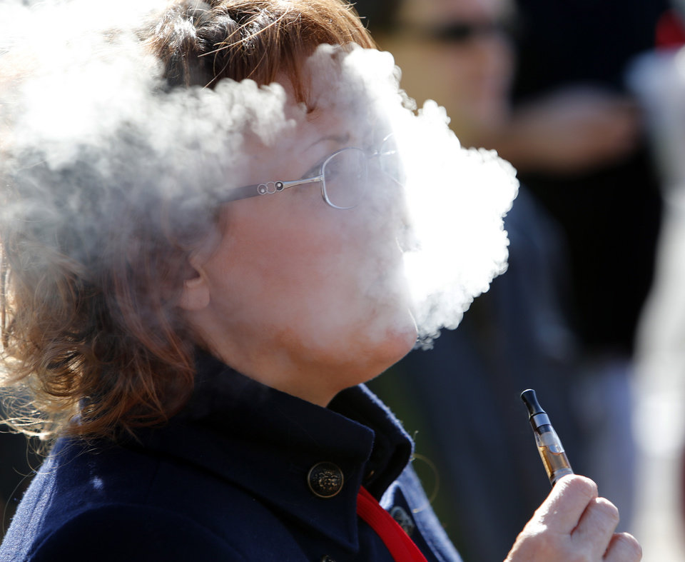 Kaye Beach of Norman smokes her e-cigarrette at a rally at the state Capitol to protest Gov. Mary Fallin's recent executive order banning e-cigarettes on state property on Wednesday, Jan. 1, 2014 in Oklahoma City Okla. Photo by Steve Sisney, The Oklahoman