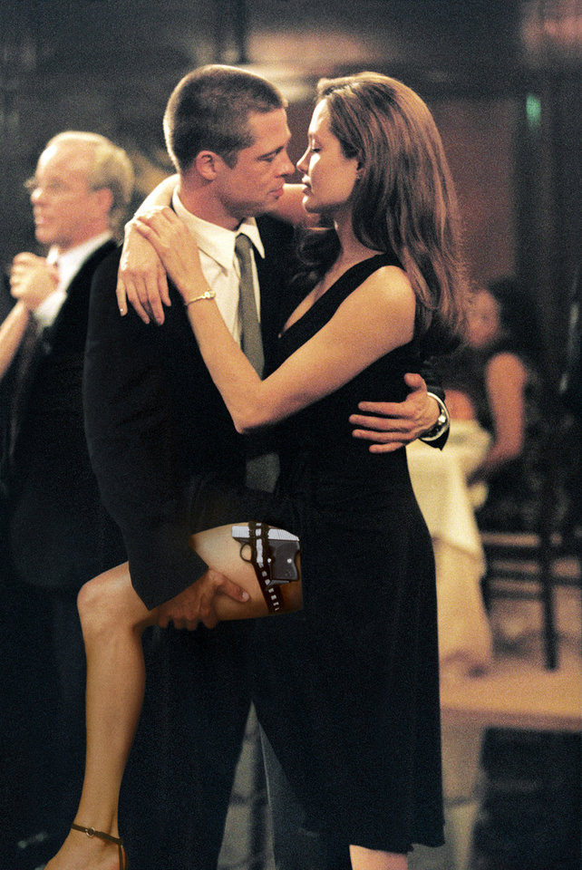 Photo - FILE - In this undated file photo provided by Twentieth Century Fox, as John Smith, played by Brad Pitt, and Jane Smith, portrayed by Angelina Jolie, do a sexy tango, more of their secrets are uncovered in