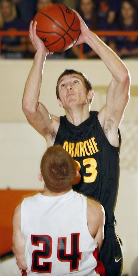 Photo - Okarche's Cody Baustert (33) shoots over Aaron Kuns (24) of Turpin during the high school basketball game between Okarche and Turpin in the Class A Boys state basketball tournament at Norman High School in Norman, Okla., Thursday, March 4, 2010. Okarche won, 42-39. Photo by Nate Billings, The Oklahoman