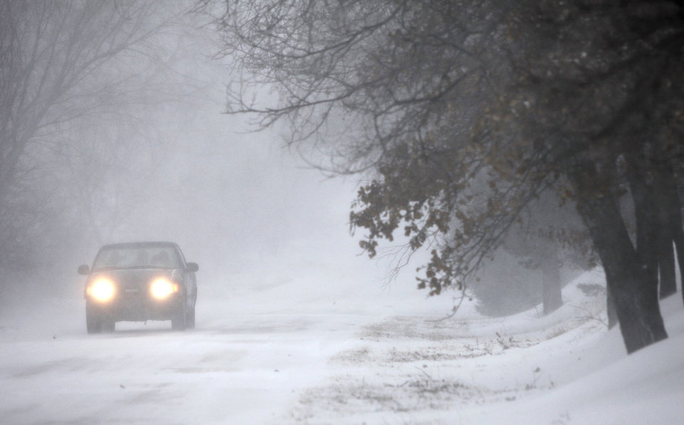 Photo -  A motorist drives east on Charter Oak road in Logan County, Oklahoma December 24, 2009. Photo by Steve Gooch, The Oklahoman
