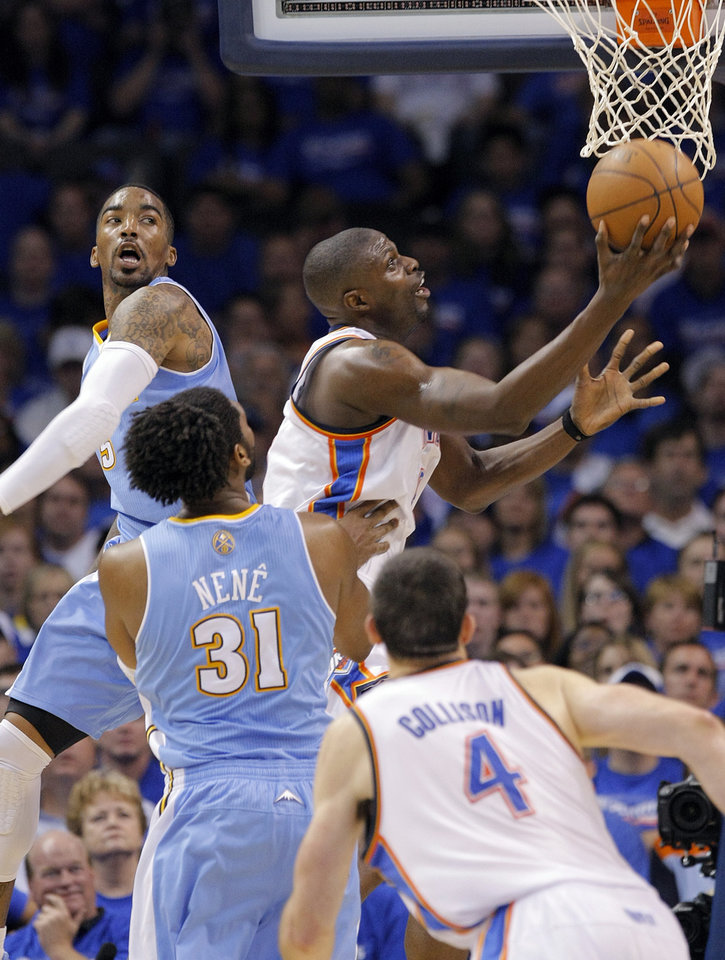 Photo - Oklahoma City's Nazr Mohammed (8) drives to the basket past Denver's J.R. Smith (5) during the first round NBA playoff game between the Oklahoma City Thunder and the Denver Nuggets on Sunday, April 17, 2011, in Oklahoma City, Okla. Photo by Chris Landsberger, The Oklahoman