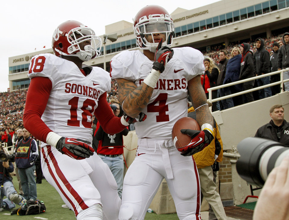 Photo - Oklahoma's Kenny Stills (4) celebrates beside Oklahoma's Lacoltan Bester (18) after a touchdown during a college football game between the University of Oklahoma (OU) and Texas Tech University at Jones AT&T Stadium in Lubbock, Texas, Saturday, Oct. 6, 2012. Oklahoma won 41-20. Photo by Bryan Terry, The Oklahoman