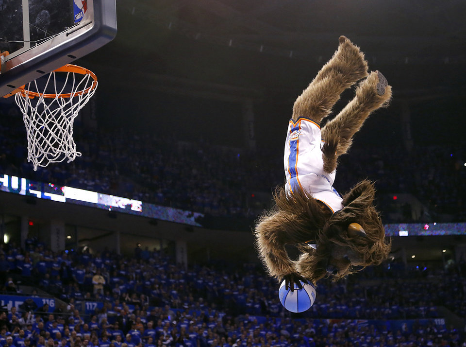 Rumble does a flip while entertaining the crowd during a timeout during the second round NBA playoff basketball game between the Oklahoma City Thunder and the Memphis Grizzlies at Chesapeake Energy Arena in Oklahoma City, Sunday, May 5, 2013. Photo by Chris Landsberger, The Oklahoman