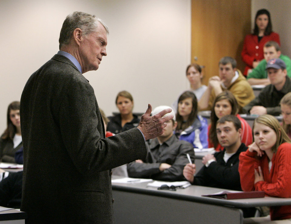 Photo - FILE - In this Tuesday, Jan. 9, 2007 file photo, former Nebraska coach and Congressman Tom Osborne teaches a class at the College of Business Administration at the University of Nebraska-Lincoln, in Lincoln, Neb. Osborne will retire as Nebraska's athletic director on Jan. 1, 2013, and end an association with the university that began in 1962. (AP Photo/Nati Harnik, File)