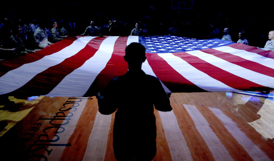 Photo - An American flag is presented before an NBA basketball game between the Oklahoma City Thunder and the Washington Wizards at Chesapeake Energy Arena in Oklahoma City, Wednesday, March 19, 2013. Oklahoma City won 103-80. Photo by Bryan Terry, The Oklahoman