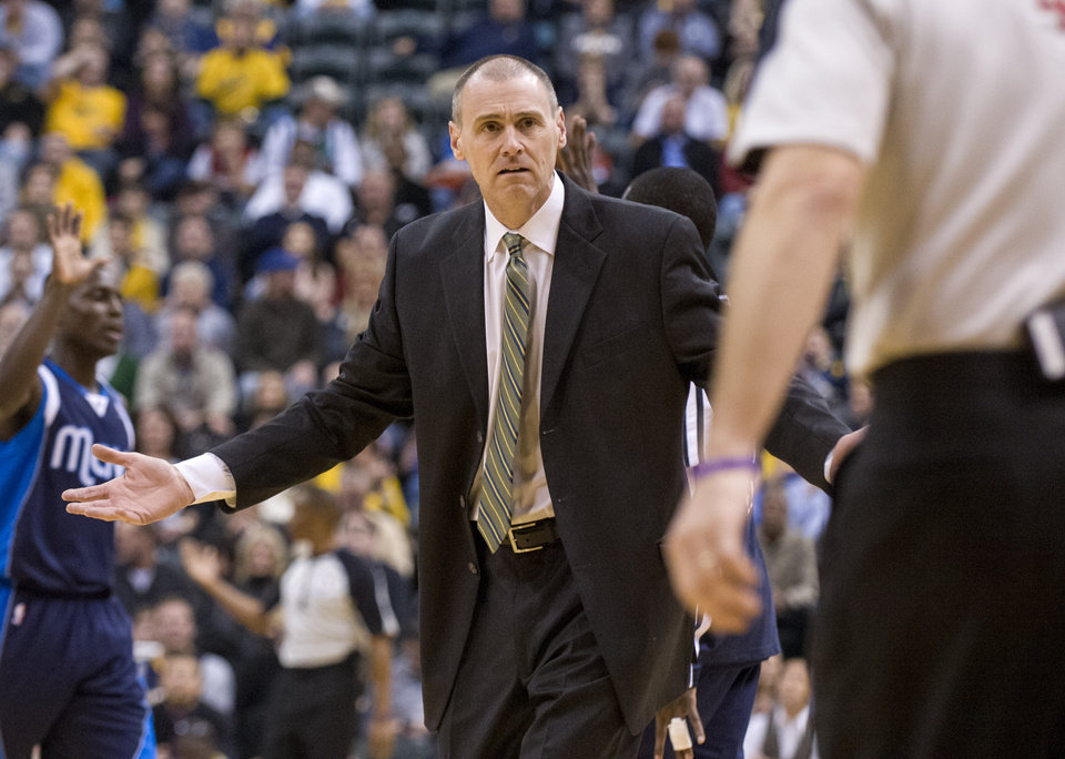 Dallas Mavericks head coach Rick Carlisle questions why a foul call was not made after one of his players fell to the floor during first-half action of an NBA basketball game against the Indiana Pacers in Indianapolis, Friday, Nov. 16, 2012. (AP Photo/Doug McSchooler)
