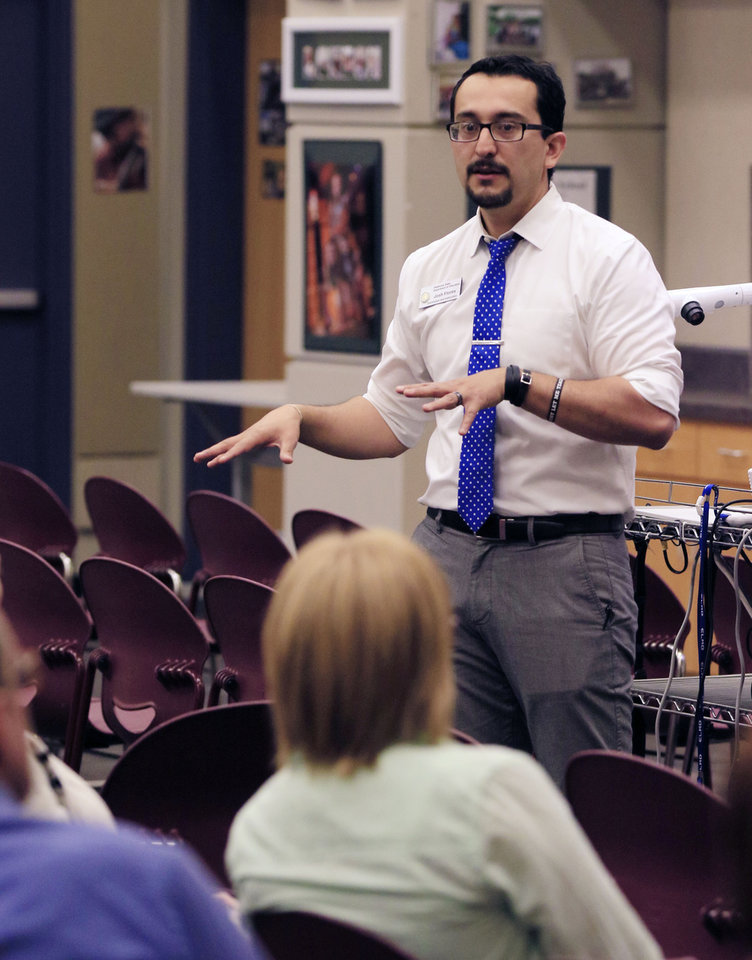 Photo -  Right: Josh Flores, director of secondary English language arts for the state Education Department