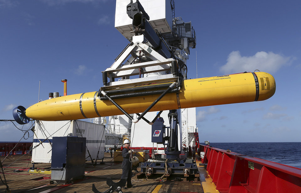Photo - In this Thursday, April 17, 2014 photo provided by the Australian Defense Force the Phoenix International Autonomous Underwater Vehicle (AUV) Artemis is craned over the side of Australian Defense Vessel Ocean Shield before launching the vehicle into the southern Indian Ocean in the search of the missing Malaysia Airlines Flight 370.  Up to 11 aircraft and 12 ships continue to scan the ocean surface for debris from the Boeing 777 that disappeared March 8 en route from Kuala Lumpur to Beijing with 239 people on board. (AP Photo/Australian Defense Force, Bradley Darvill) EDITORIAL USE ONLY