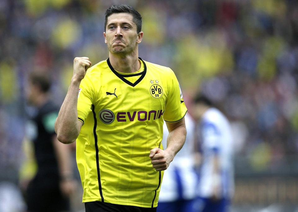 Photo - Dortmund's Robert Lewandowski of Poland celebrates scoring his side's opening goal during the German Bundesliga soccer match between Hertha BSC Berlin and Borussia Dortmund in  in Berlin, Germany, Saturday, May 10, 2014. (AP Photo/Michael Sohn)