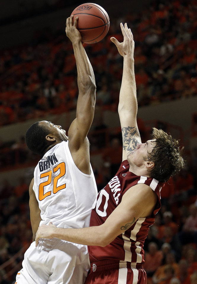Photo - Oklahoma's Ryan Splanger (00) blocks the shot Oklahoma State's Markel Brown (22) during the men's Bedlam college game between Oklahoma and Oklahoma State at Gallagher-Iba Arena in Stillwater, Okla., Saturday, Feb. 15, 2014. Photo by Sarah Phipps, The Oklahoman