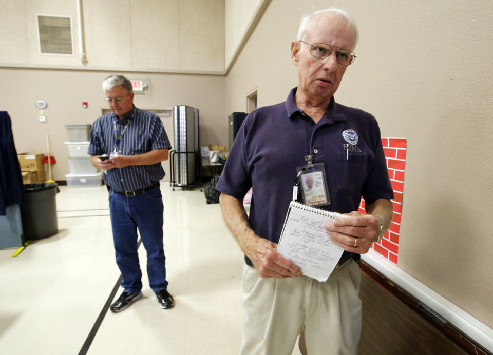 FEMA public Information Officer Nate Custer, right, and SBA Public information officer William Koontz man the disaster recovery center at Capitol Hill Baptist Church on Wednesday, July 17, 2013, in Oklahoma City, Okla.  Photo by Steve Sisney, The Oklahoman