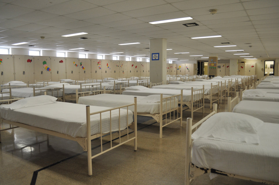 Photo -  This is one of the dormitories for immigrant minors at Fort Sill in Lawton. Juveniles are separated by gender and housed 60 to a dorm. Photo Sprovided    PROVIDED