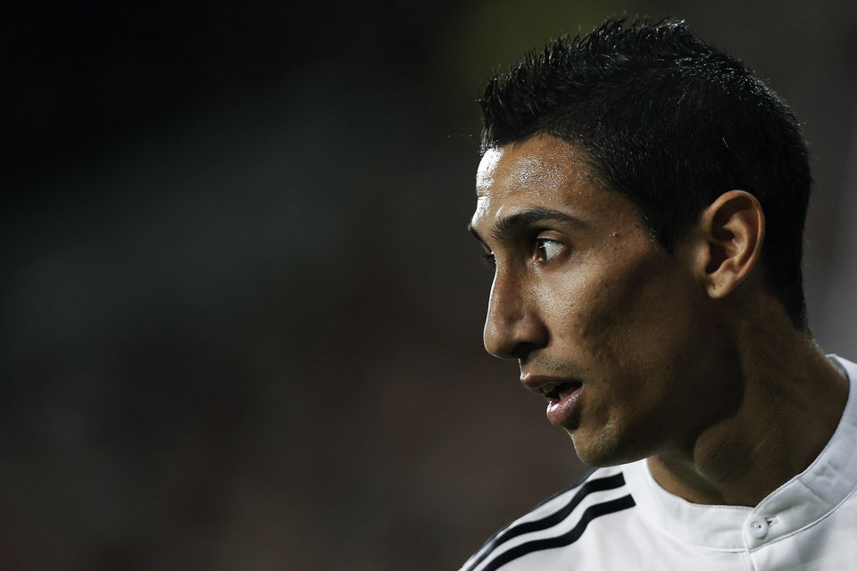 Photo - Real Madrid's Angel Di Maria from Argentina reacts during a Spanish Super Cup soccer match against Atletico Madrid at Santiago Bernabeu stadium in Madrid, Spain, Tuesday, Aug. 19, 2014 . (AP Photo/Daniel Ochoa de Olza)