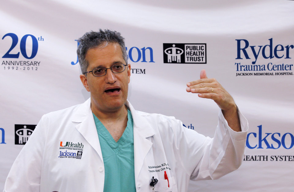 Photo - Dr. Nicholas Namias, medical director of Ryder Trauma Center, speaks during a news conference on how the center handled patients from a Dec. 1 bus crash, Tuesday, Dec. 4, 2012 in Miami. Two passengers on the bus that smashed into a concrete overpass at Miami International Airport Dec. 1, remain in critical condition in a hospital. Officials at Ryder Trauma Center and the Jackson Memorial Hospital Emergency Room say four other patients are in stable condition and six have been discharged. One person died at the hospital after Saturday's crash and another died at the scene. (AP Photo/Wilfredo Lee)