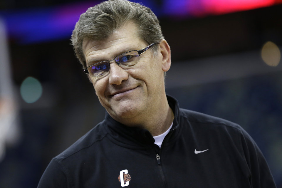 Photo - Connecticut head coach Geno Auriemma smiles during practice at the Women's Final Four of the NCAA college basketball tournament, Saturday, April 6, 2013, in New Orleans.  UConn plays Notre Dame in a semifinal game on Sunday. (AP Photo/Dave Martin)