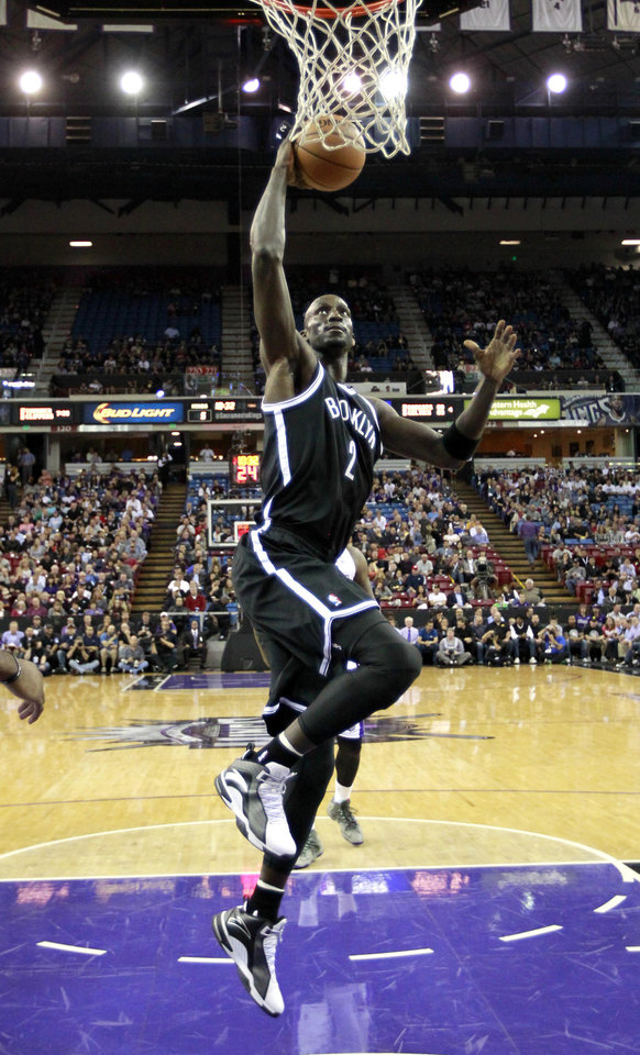Photo - Brooklyn Nets forward Kevin Garnett goes to the basket against the Sacramento Kings during the first quarter of an NBA basketball game in Sacramento, Calif., Wednesday, Nov. 13, 2013. (AP Photo/Rich Pedroncelli)