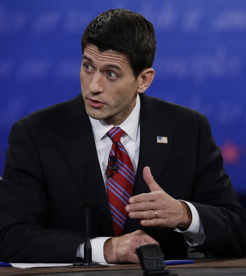 Republican vice presidential nominee, Rep. Paul Ryan, of Wisconsin, makes a point during the vice presidential debate with Vice President Joe Biden at Centre College, Thursday, Oct. 11, 2012, in Danville, Ky. (AP Photo/Eric Gay)