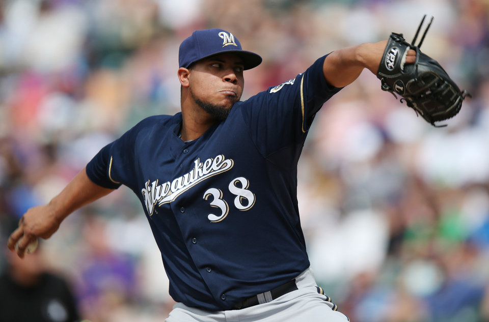 Photo - Milwaukee Brewers starting pitcher Wily Peralta works agaisnt the Colorado Rockies in the third inning of a baseball game in Denver, Saturday, June 21, 2014. (AP Photo/David Zalubowski)