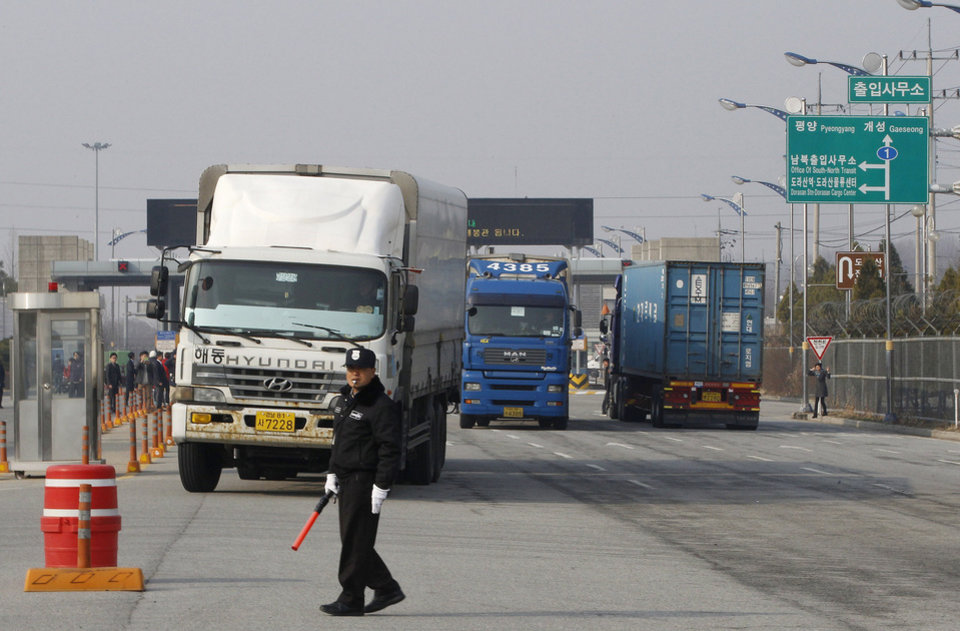 Photo - South Korean trucks turn back their way as they were refused to enter North Korea's city of Kaesong, at the customs, immigration and quarantine office in Paju, South Korea, near the border village of Panmunjom, Thursday, April 4, 2013. North Korean border authorities refused to allow entry to South Koreans who manage jointly run factories in Kaesong. (AP Photo/Ahn Young-joon)