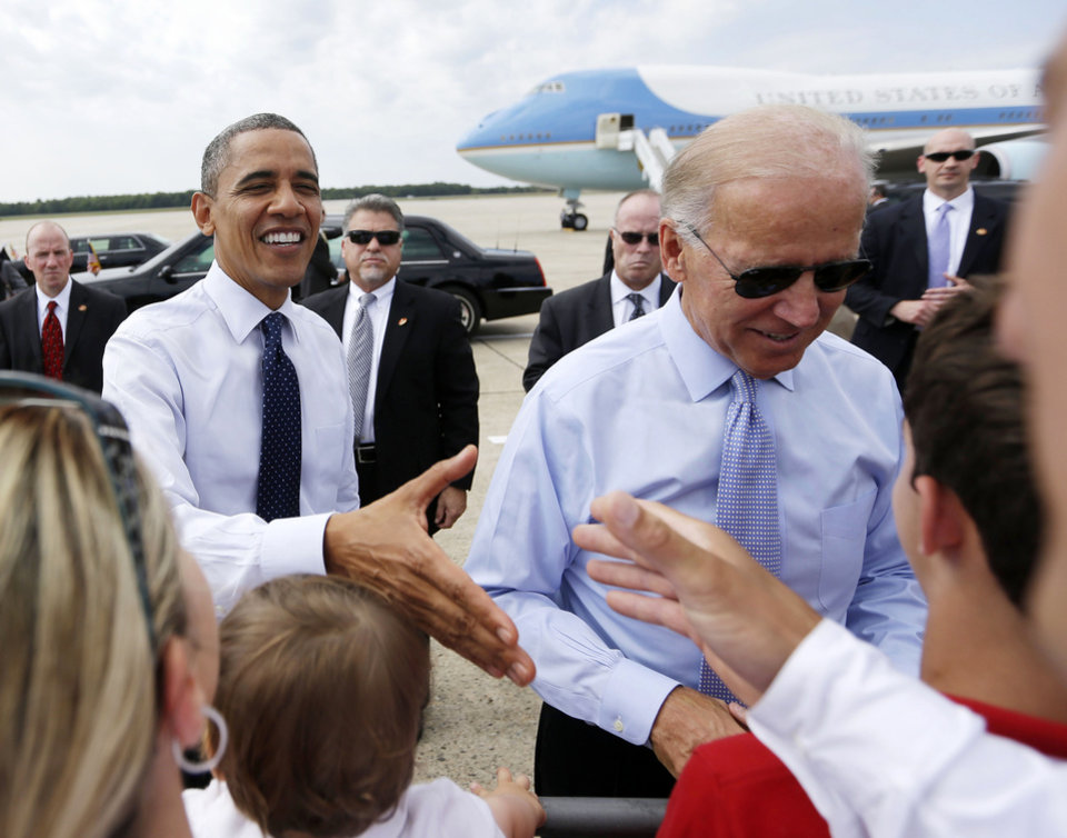Photo -   President Barack Obama and Vice President Joe Biden greet supporters on the tarmac upon their arrival at Portsmouth International Airport at Pease, Friday, Sept. 7, 2012, in Portsmouth, N.H. (AP Photo/Pablo Martinez Monsivais)