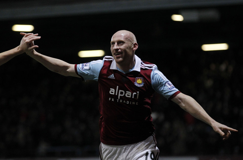 West Ham United's James Collins celebrates his goal against Norwich City during their English Premier League soccer match at Upton Park, London, Tuesday, Feb. 11, 2014. (AP Photo/Sang Tan)