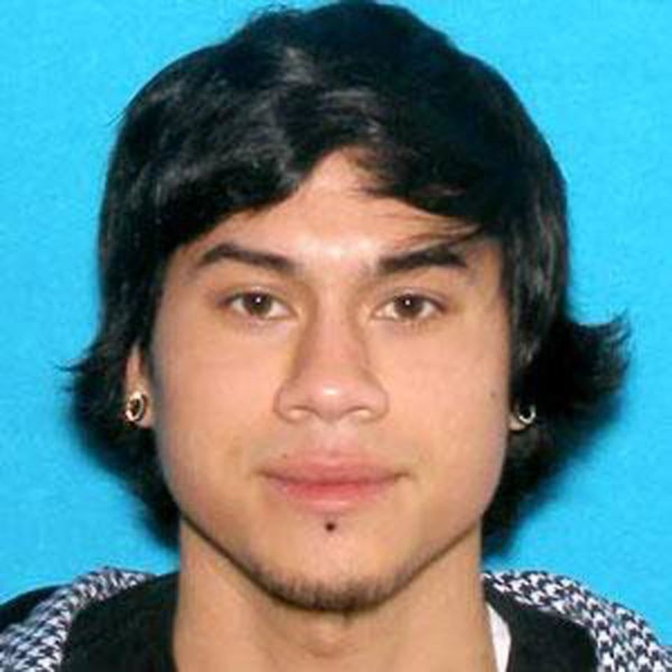 Photo - This photo provided by the Clackamas County Sheriff's Department shows Jacob Tyler Roberts, the suspect in a shooting at an Oregon Mall on Tuesday Dec. 11, 2012. Roberts, who killed two people and himself in the shooting rampage, was 22 years old and used a stolen rifle from someone he knew, authorities said Wednesday. Roberts had armed himself with an AR-15 semiautomatic rifle and had several fully loaded magazines when he arrived at a Portland mall on Tuesday, said Clackamas County Sheriff Craig Roberts. (AP Photo/Clackamas County Sheriff's Department) ORG XMIT: FX101