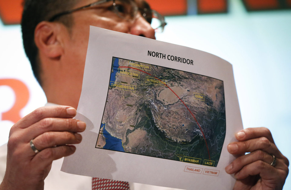 Photo - Malaysia's acting Transport Minister Hishamuddin Hussein shows the map of northern search corridor during a press conference at a hotel next to the Kuala Lumpur International Airport, in Sepang, Malaysia, Monday, March 17, 2014. Twenty-six countries are involved in the massive international search for the Malaysia Airlines jetliner that disappeared on March 8 with 239 people aboard. They include not just military assets on land, at sea and in the air, but also investigators and the specific support and assistance requested by Malaysia, such as radar and satellite information. (AP Photo/Vincent Thian)