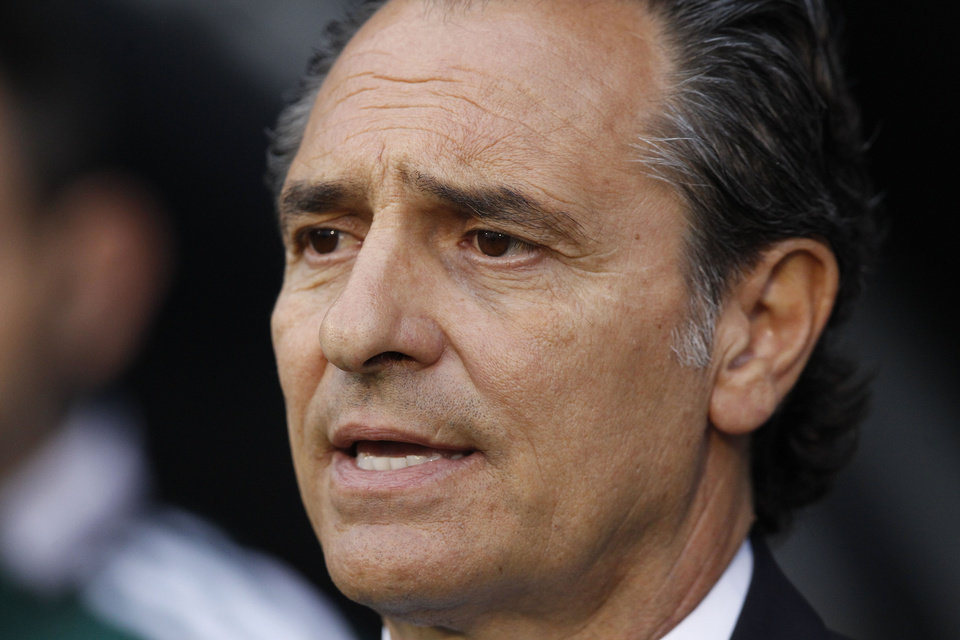 Photo - Italy's head coach Cesare Prandelli looks on from the dugout before the start of their international friendly soccer match against Republic of Ireland at Craven Cottage, London, Saturday, May 31, 2014. (AP Photo/Sang Tan)