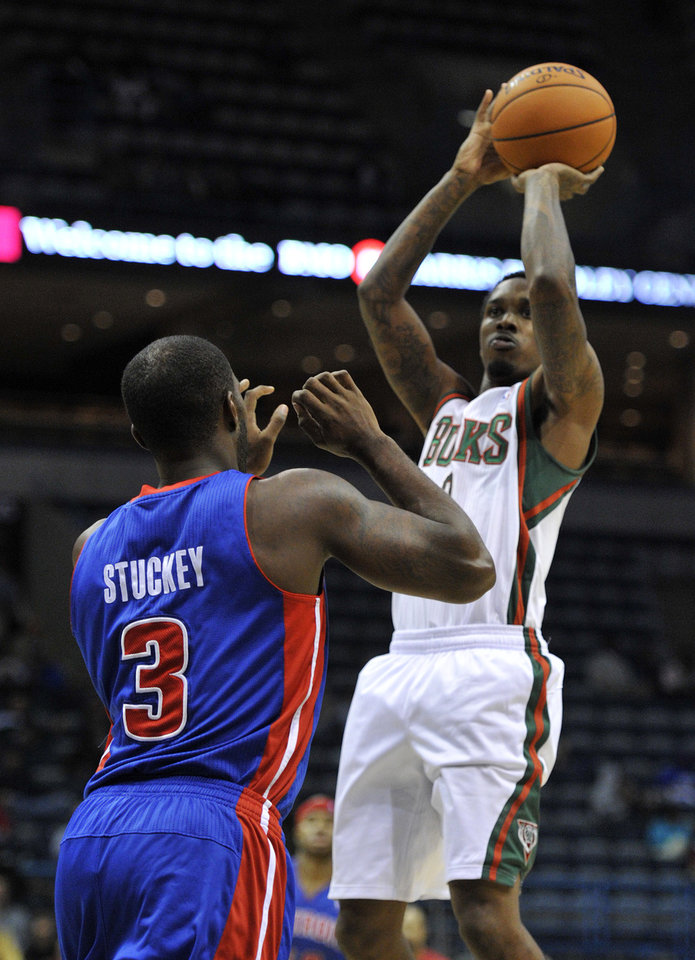 Detroit Pistons' Rodney Stuckey (3) defends as Milwaukee Bucks' Brandon Jennings shoots the ball during the second half of an NBA basketball game on Saturday, Oct. 13, 2012, in Milwaukee. The Bucks defeated the Pistons 108-91. (AP Photo/Jim Prisching)