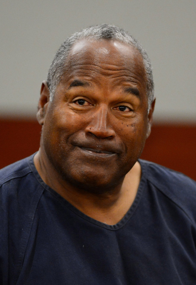 Photo - O. J. Simpson appears for the second day of an evidentiary hearing in Clark County District Court, Tuesday, May 14, 2013 in Las Vegas.  The hearing is aimed at proving Simpson's trial lawyer, Yale Galanter,  had conflicted interests and shouldn't have handled Simpson's case. Simpson is serving nine to 33 years in prison for his 2008 conviction in the armed robbery of two sports memorabilia dealers in a Las Vegas hotel room. (AP Photo/Ethan Miller, Pool)