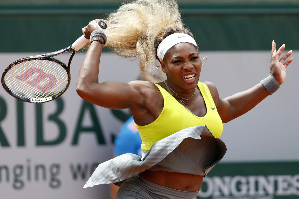 Serena Williams of the U.S. returns the ball during the second round match of the French Open tennis tournament against Spain\'s Garbine Muguruza at the Roland Garros stadium, in Paris, France, Wednesday, May 28, 2014. (AP Photo/Darko Vojinovic)