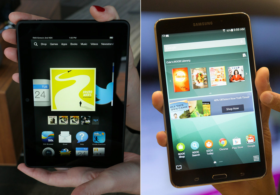 Photo - This combination of file photos shows the 7-inch Amazon Kindle HDX tablet, left, and the Samsung Galaxy Tab 4 Nook. (AP Photo/Ted S. Warren, John Minchillo, File)