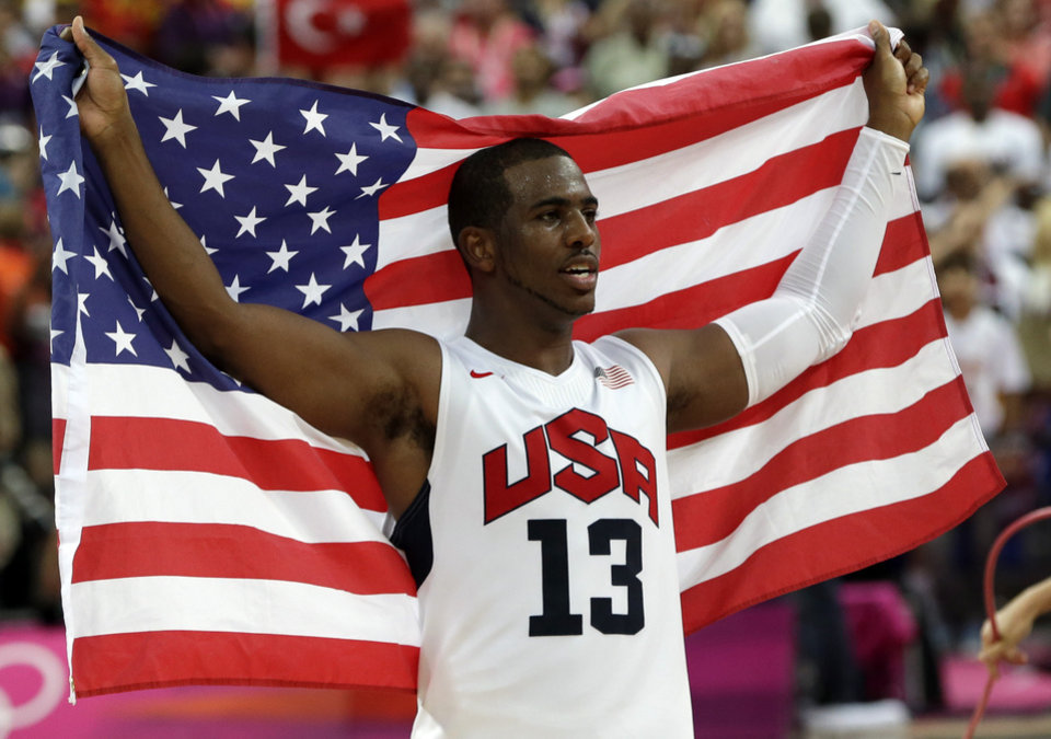 United States' Chris Paul celebrates after the men's gold medal basketball game at the 2012 Summer Olympics, Sunday, Aug. 12, 2012, in London. USA won 107-100. (AP Photo/Eric Gay)