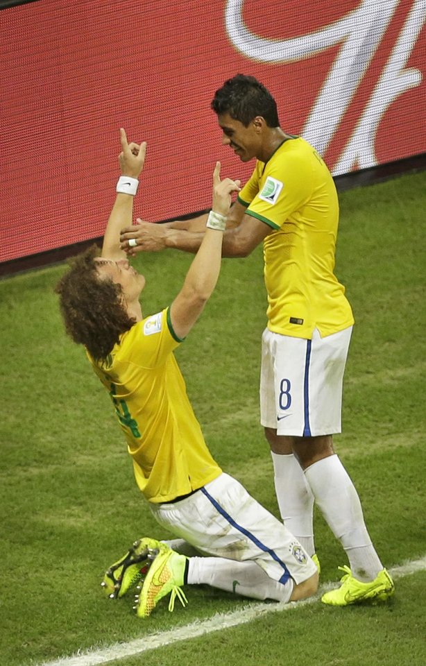 Photo - Brazil's David Luiz, left, celebrates with his teammate Paulinho after scoring his side's second goal during the World Cup quarterfinal soccer match between Brazil and Colombia at the Arena Castelao in Fortaleza, Brazil, Friday, July 4, 2014. (AP Photo/Themba Hadebe)