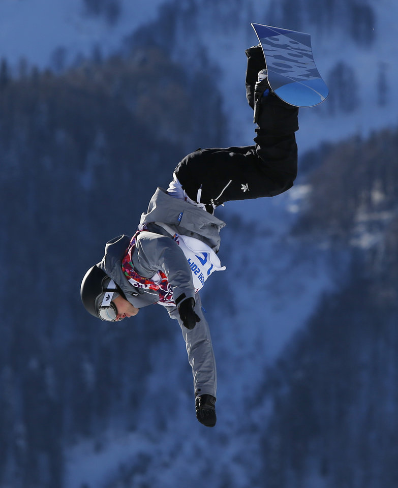 Photo - Austria's Mathias Weissenbacher takes a jump during men's snowboard slopestyle qualifying at the Rosa Khutor Extreme Park ahead of the 2014 Winter Olympics, Thursday, Feb. 6, 2014, in Krasnaya Polyana, Russia. (AP Photo/Sergei Grits)